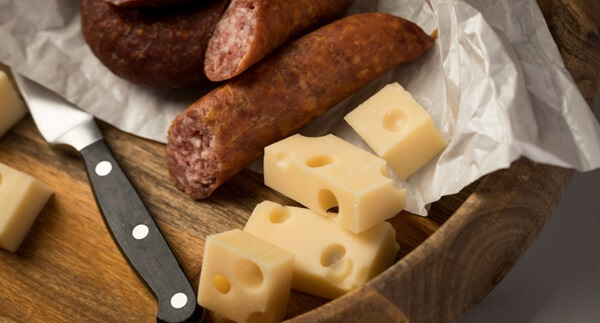 Utility Knife Cutting Salami and Cheese in Kitchen