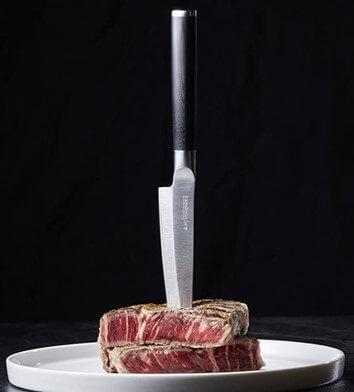 Kamikoto Utility Knife cutting steak