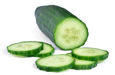 cucumber sliced safely on mandoline slicer